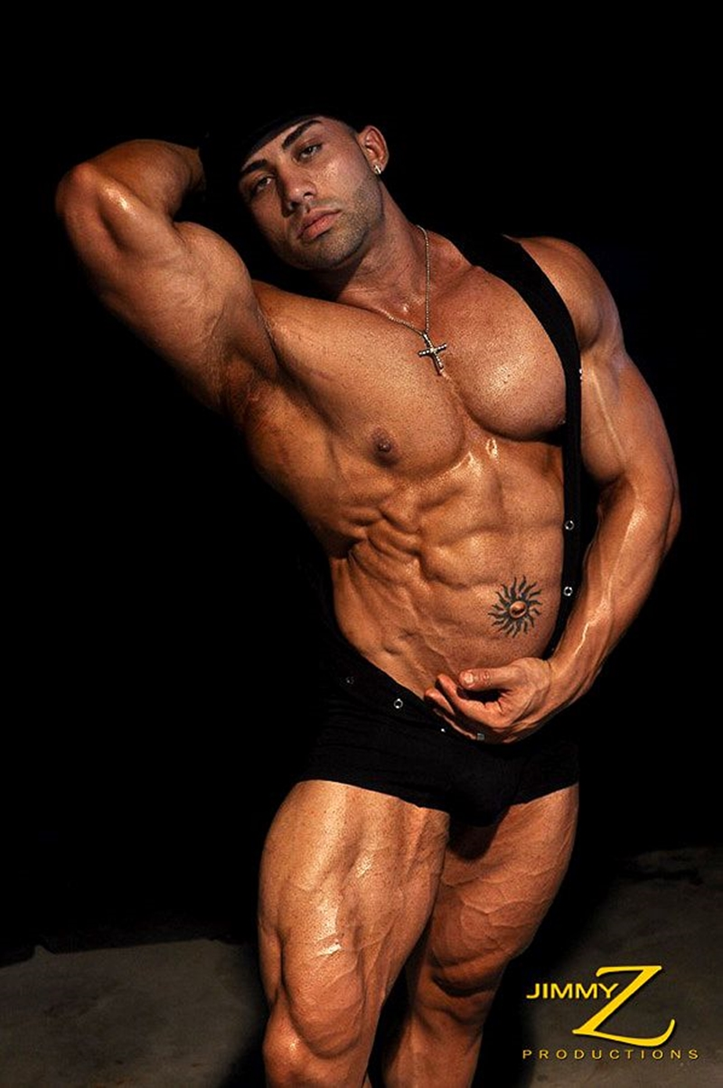 JimmyZProductions-Alavi-Damante-bodybuilder-muscles-oiled-ripped-body-thong-glutes-naked-cigar-smoking-005-male-tube-red-tube-gallery-photo