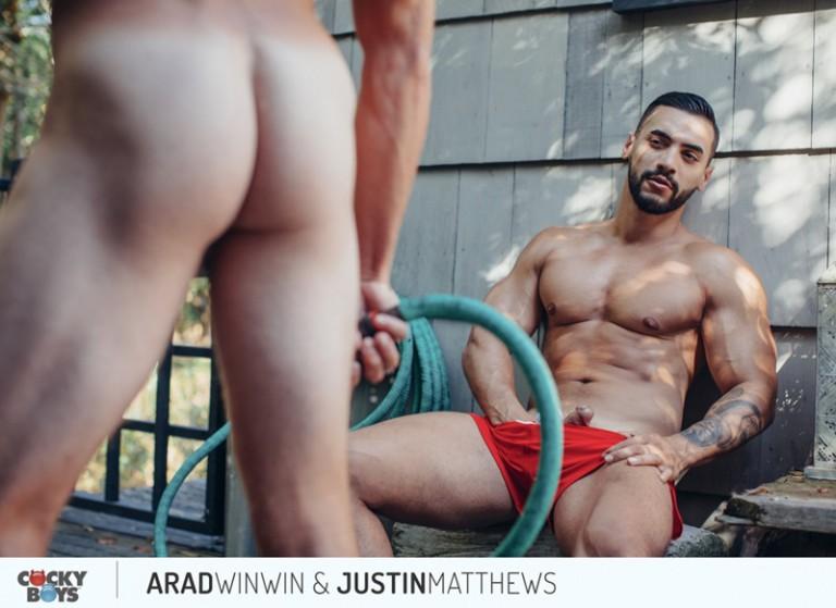 Justin Matthews can feel Arad Winwin's huge hard cock against his ass cheeks